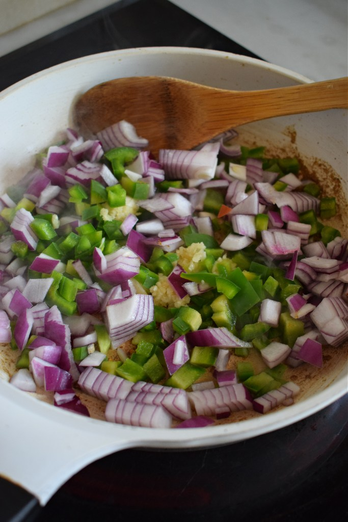 vegetables in a pan to make mexican rice