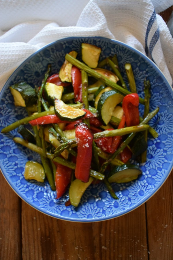 sheet pan vegetables in a blue bowl