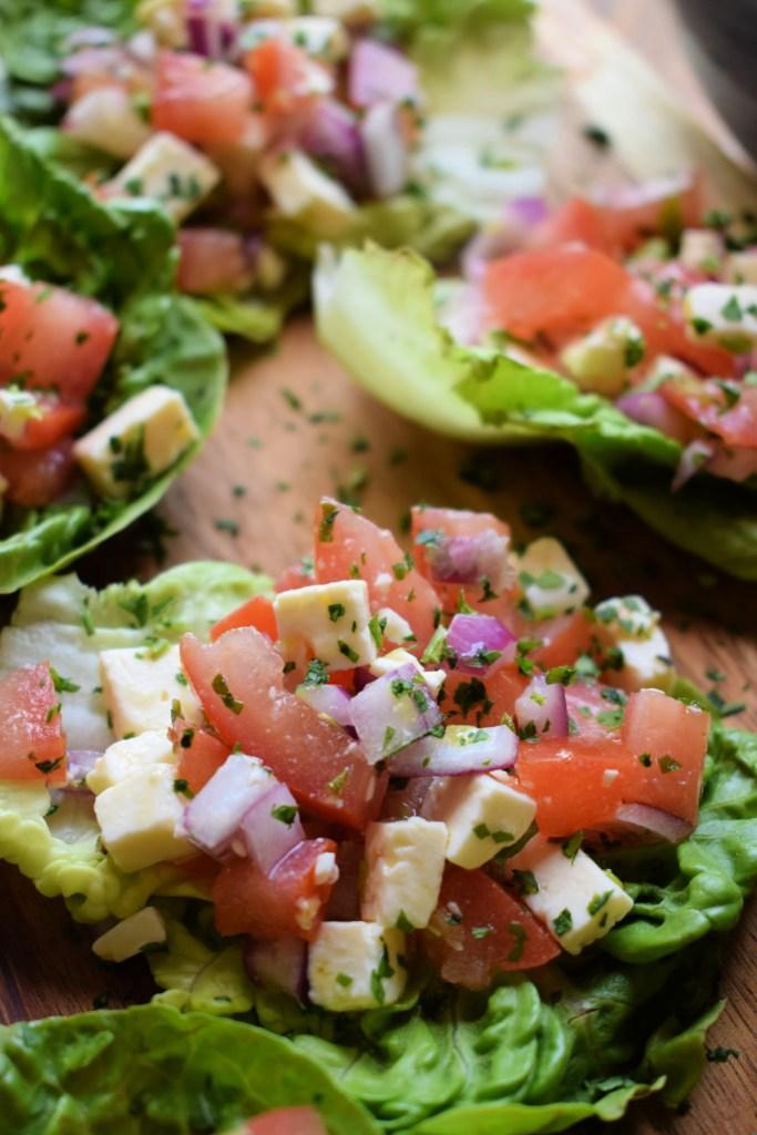 close up of the feta and tomatoa salad cups