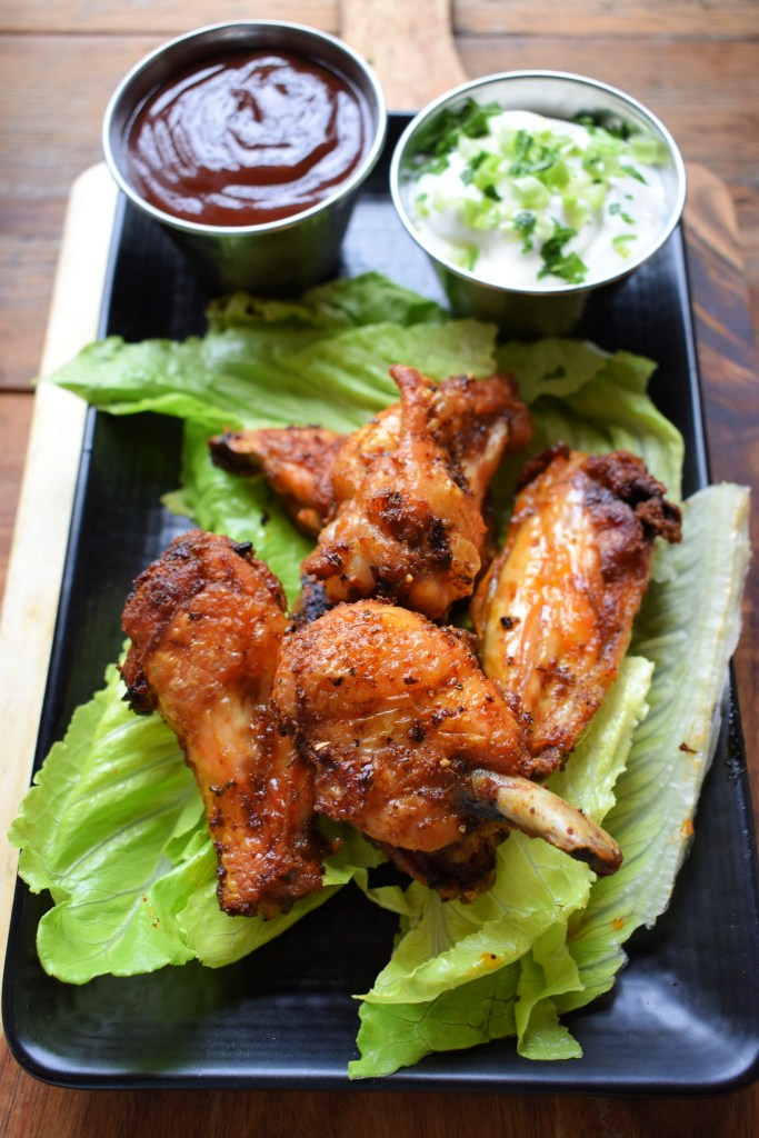 Oven baked crispy chicken wings with dipping sauces
