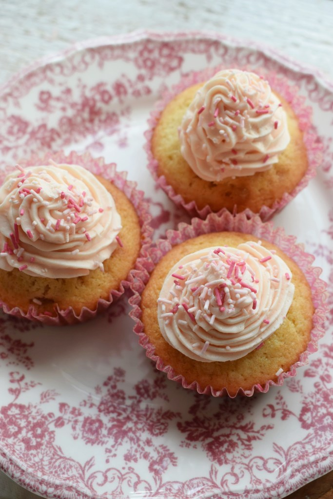 Fresh Strawberries with Buttercream Frosting on a pink pretty plate