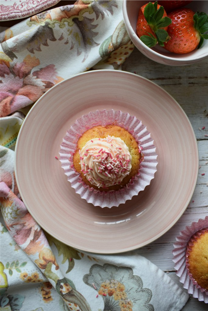 Cupcake on a plate with strawberries