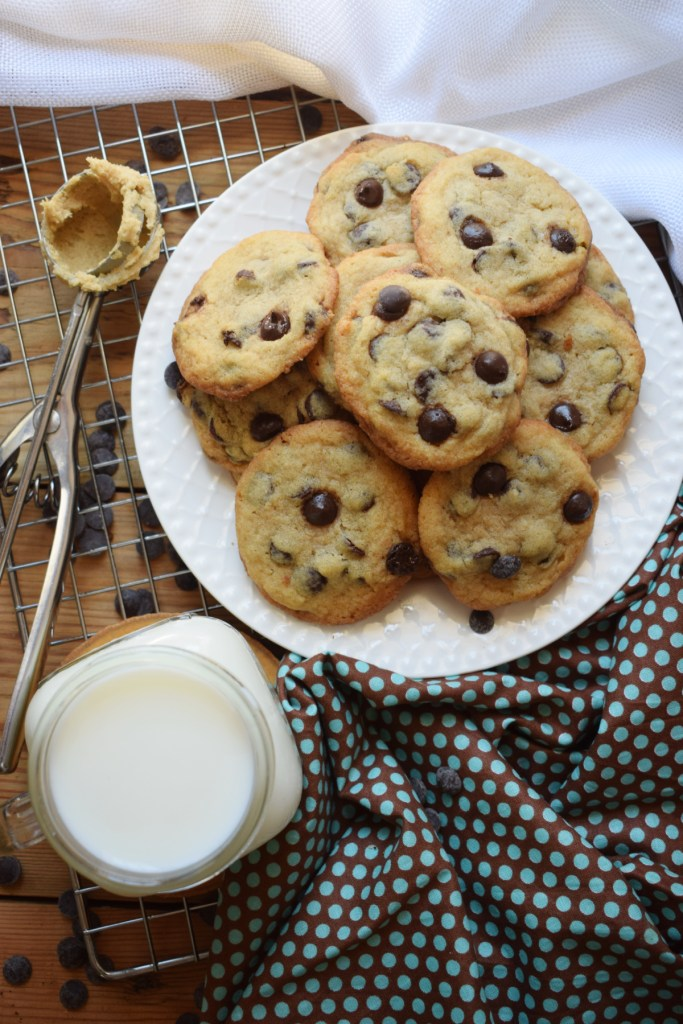 over head view of chocolate chip cookies and a glass of milk
