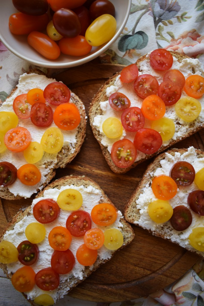 cherry tomatoes and ricotta cheese on toast