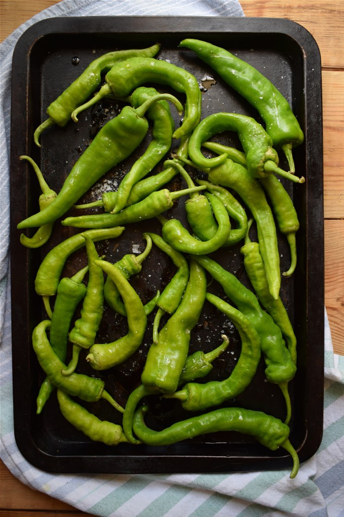 green peppers on a baking tray ready to roast