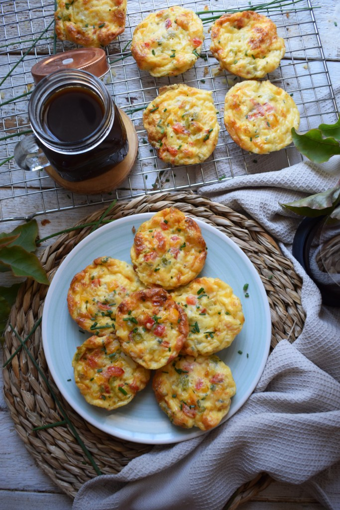 over head table setting view of the bell pepper and egg breakfast muffins