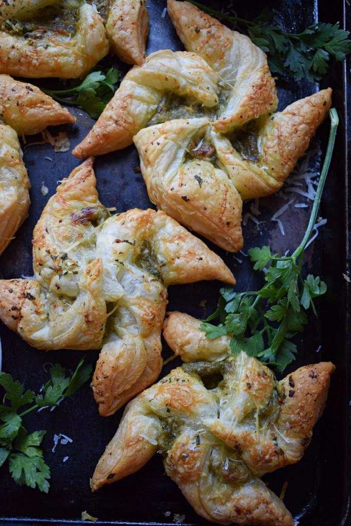pesto puff pastry pinwheels on a baking tray