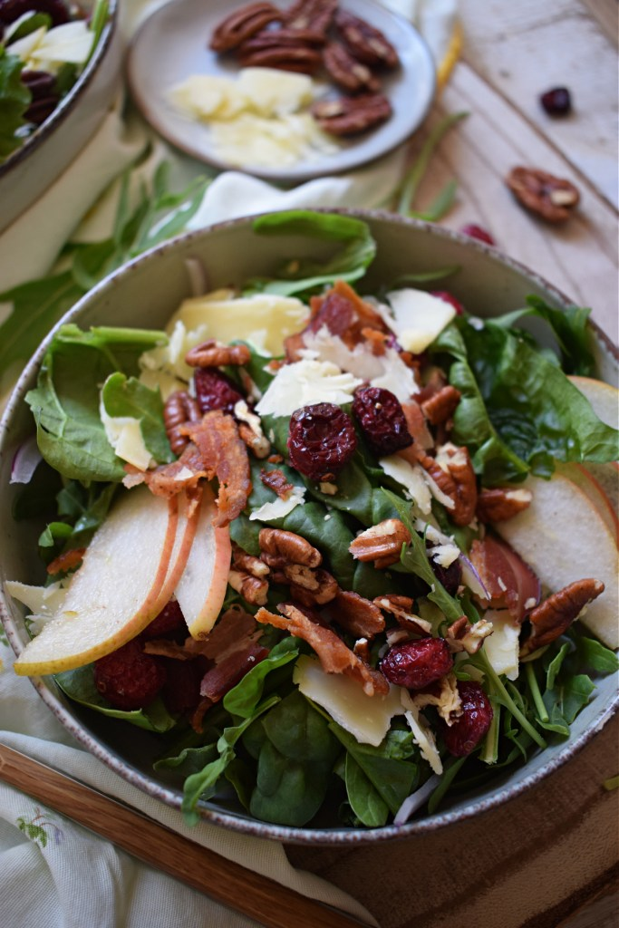 close up of the pear and pecan salad with dried cranberries