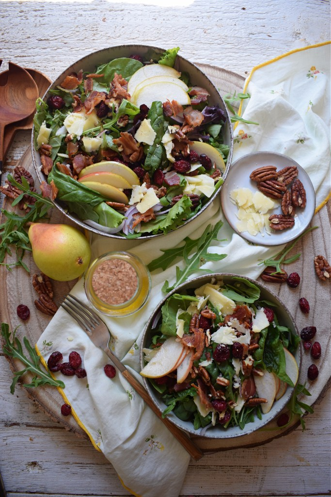 over head table setting view of the pear and pecan salad