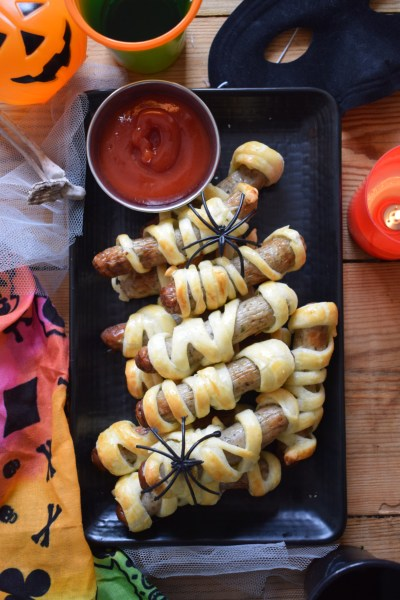 table decorated with mummy sausage rolls