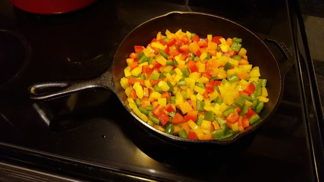 Sauteing bell peppers in a cast iron skillet