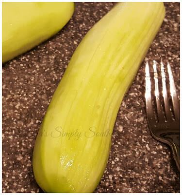 Score Cucumber with a fork