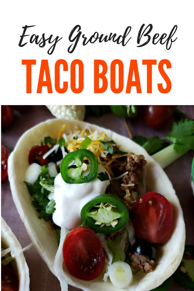 Easy ground beef and cheese taco boats with favorite toppings of lettuce, tomatoes, jalapenos, sour cream and black olives (or your favorite toppings), perfect for family dinners, Taco Tuesday, or Cinco de Mayo #TacoTuesday #BeefTaco #tacobowls #tacoboat #CincodeMayo #EasyRecipes #GroundBeef