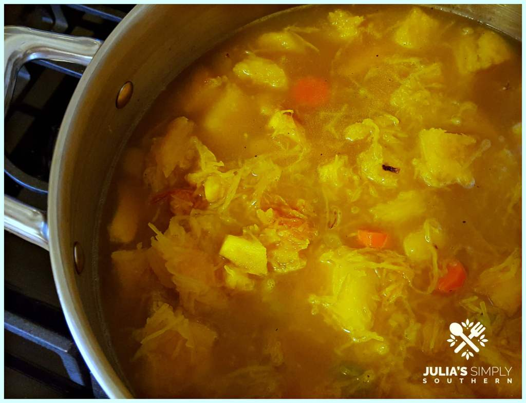 Making fresh pumpkin soup in a stainless soup pot on a gas stove top