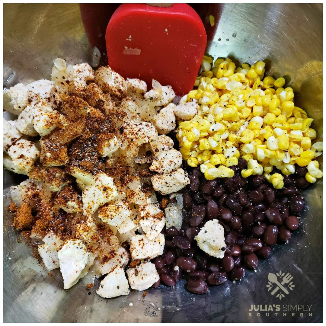 Mixing the Southwest chicken mixture for poblano peppers to bake in the oven with cheese