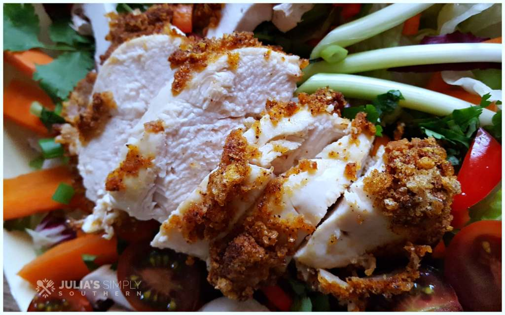 Delicious air fried chicken on a garden salad