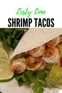 Zesty Lime Shrimp Tacos in soft flour tortilla shells with toppings such as lettuce, fresh cilantro, guacamole and sour cream or salsa #seafood #creole #fresh #EasyRecipes