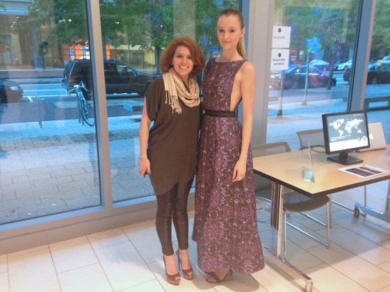 Descience also hosted a viewing of a selection of the designs in the Koch Institute Public Galleries at 500 Main Street in Cambridge, Ma. Designer Tatiana Tejedor of Team Quorum54, stands with her design. The printed gown was heavy and had spots of white paint that fluoresced under a black light to symbolize bacteria.