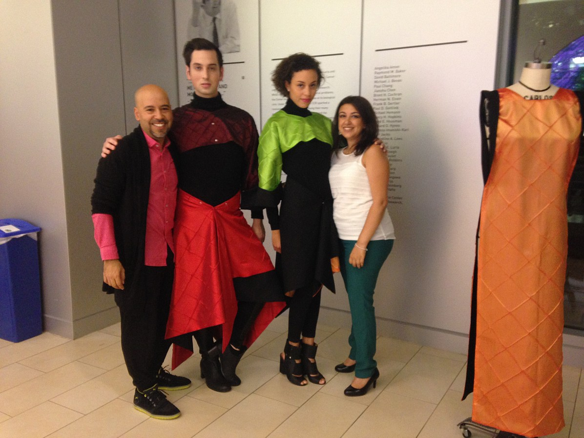 Scientist Laura Indolfi and Designer Carlos Villamil of Team Cytoouture poses with their models
