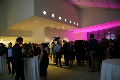 The 6th floor of the MIT Media Lab was laid out to include a large open area with a bar, tables and large screens with videos of the collaborations in progress.