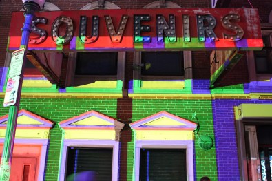 The brightly illuminated exterior of the souvenir shop was a vibrant addition to the illuminated street.