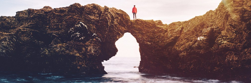 woman on a rocky arch
