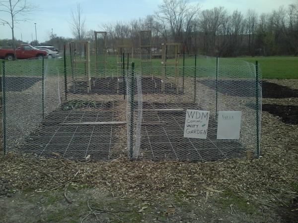 community garden plot with fence