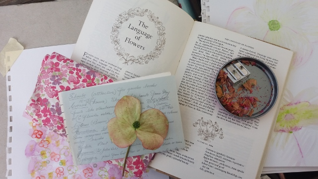 books, pressed flower, pencil sharpener and painting