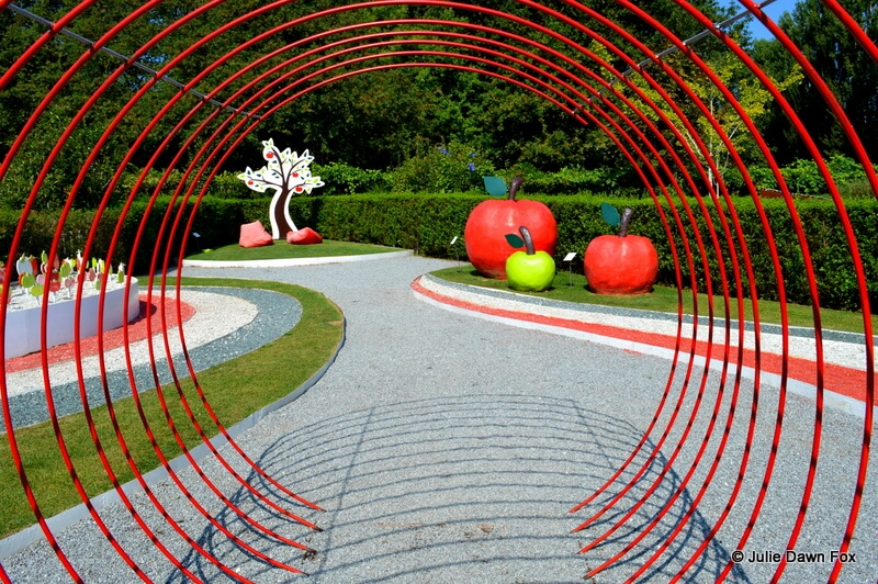 Enter the garden of Paradise through a tunnel of red curved rails.