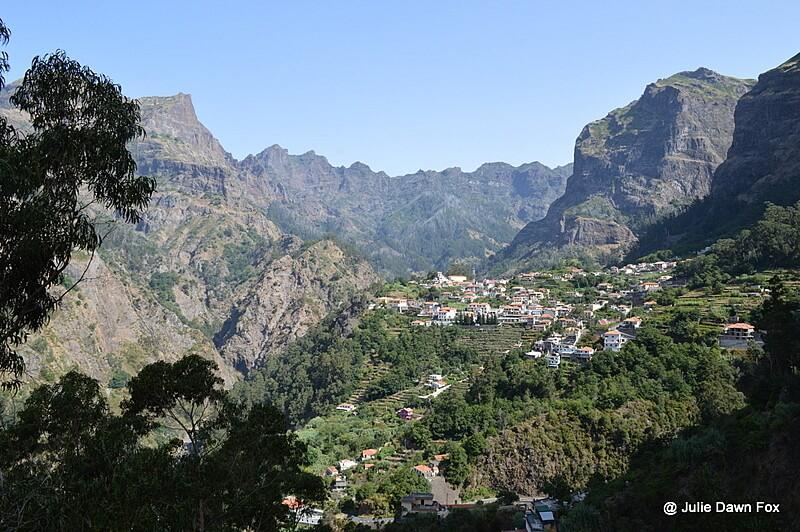 Curral das Freiras nestled in mountains. One of 3 easy walks in Madeira, Portugal