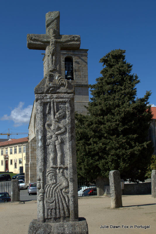 Legend of the Barcelos cockerel depicted on a stone cross
