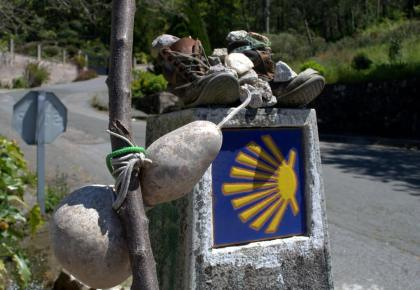 Walking boots, staff, gourd and shell. What to pack for the Portuguese Way of St. James. Camino packing list