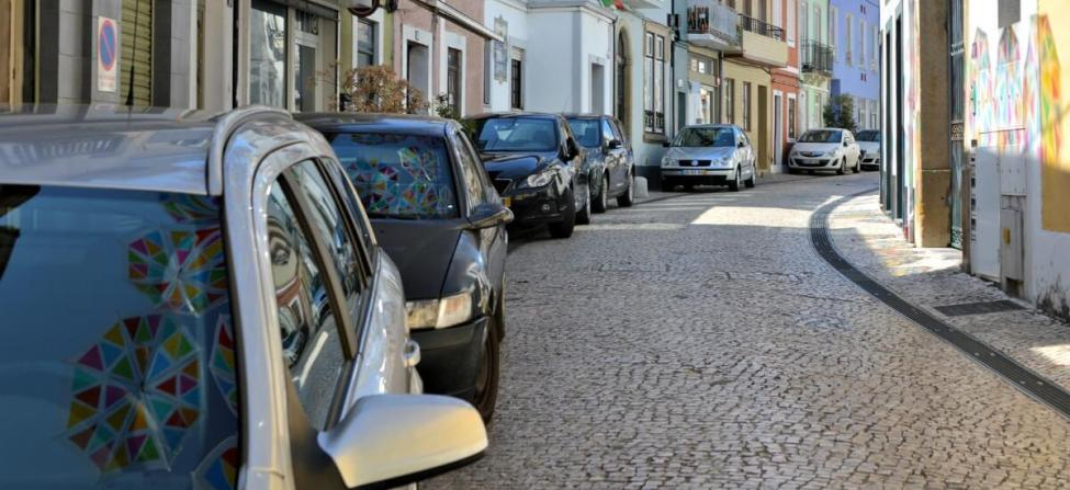 Portugal car rental tips. Cars parked in a cobbled street