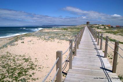 wooden-boardwalk-leadign-to-a-disused-windmill-near-agucadoura-coastal-portuguese-way-of-st-james