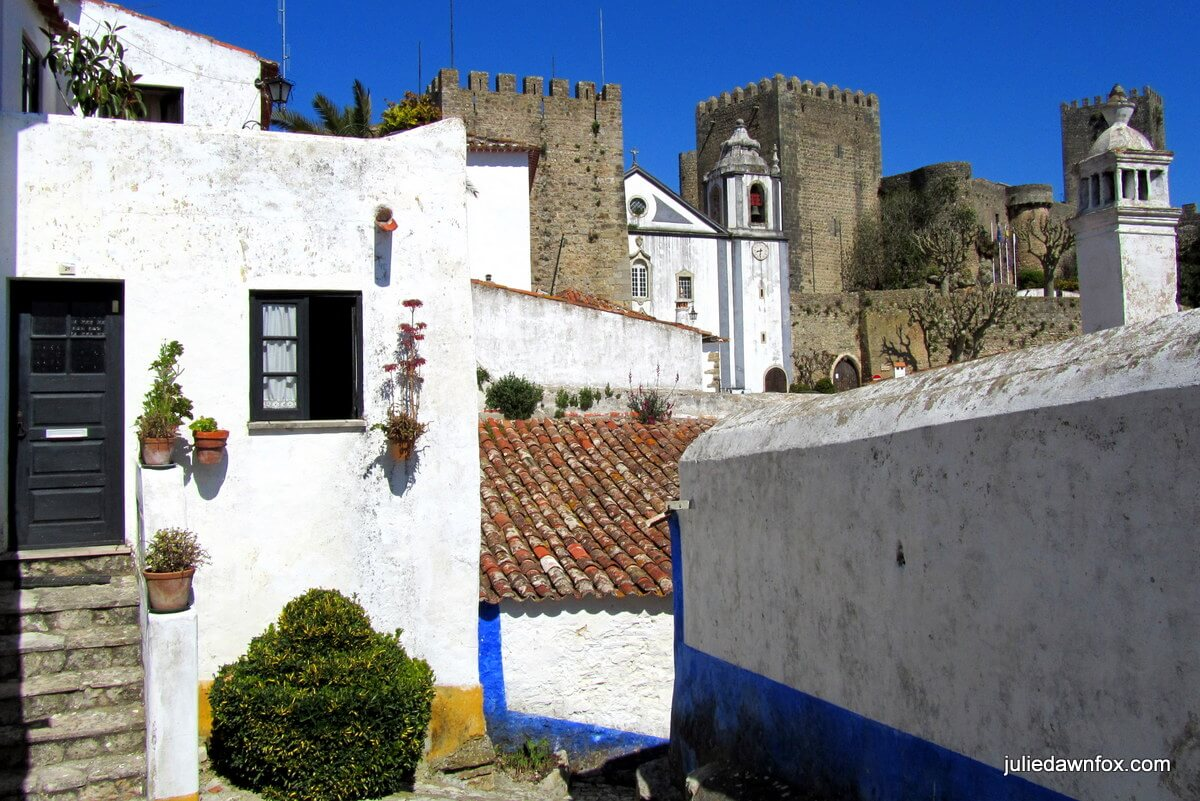 Jumble of cottages, church and castle, Óbidos, Portugal
