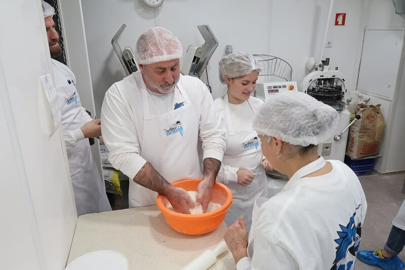Mixing flour and sugar. Pastel de nata workshop, Pastelaria Batalha in Lisbon