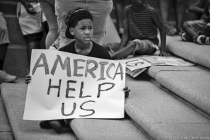 Boy on the steps of the Louisiana State Capitol Building during a rally on Sunday, July 10, 2016. About 1000 people turned out to a rally and march in Baton Rouge, LA in response to the police killing of Alton Sterling.