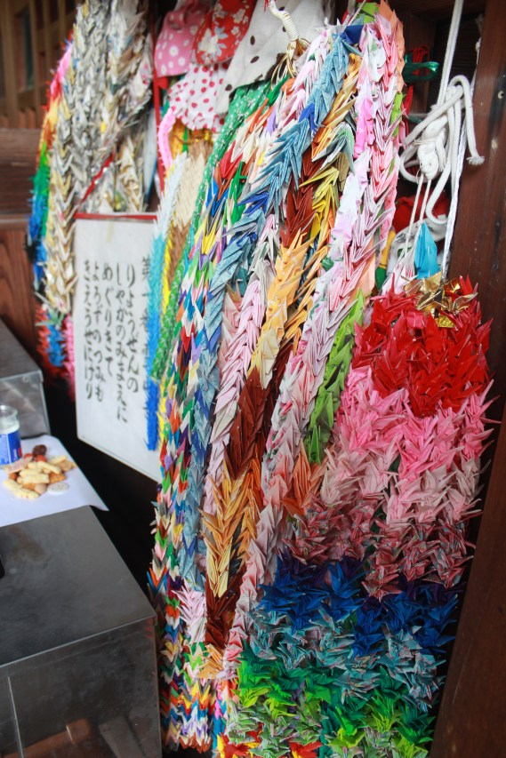 A thousand crane origami. It is believed that folding a thousand cranes will help someone get cured from a disease if offered to the temple. This is also done to make a wish for someone or for yourself.