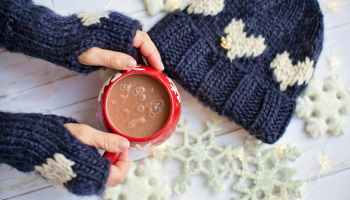person holiday cup of cocoa
