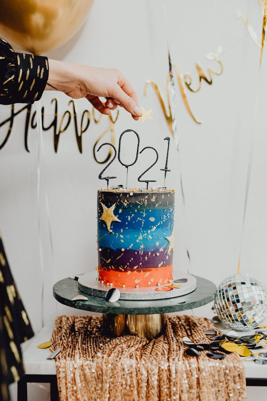 cake with 2021 candle to celebrate new year