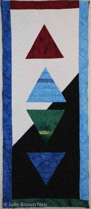 art quilt with symbols of 4 elements fire, air, earth, water