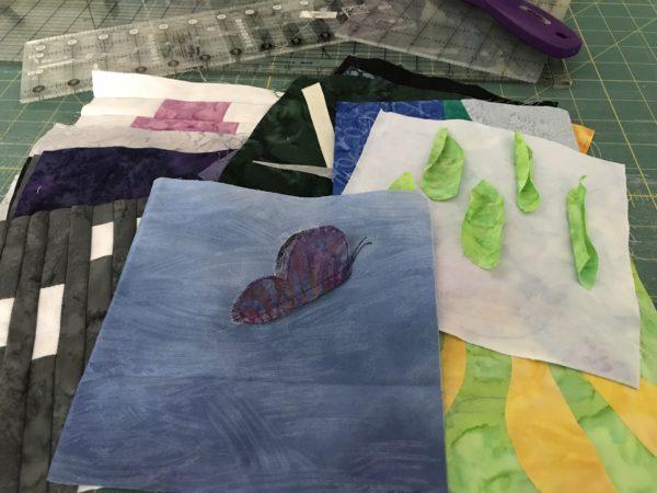 pile of improv quilt blocks