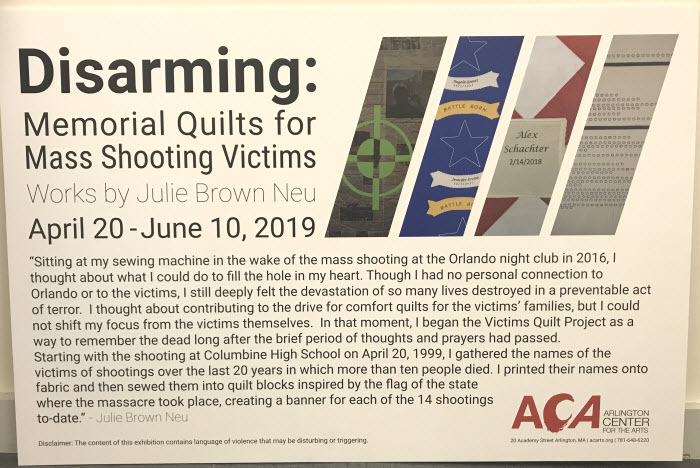 """Disarming: Memorial Quilts for Mass Shooting Victims"""" sign"""