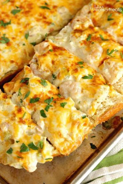 Shrimp & Artichoke French Bread - A perfect appetizer made with a cheesy, creamy topping filled with shrimp and artichokes!