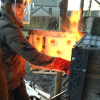 Joe adding wood across the hobs. Very hot work!