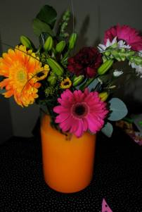 I used a couple drops of neon orange paint to color the water. I don't know if I'd ever do this again - it was a good idea in theory, but it ended up looking like the flowers were in orange juice!