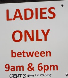 the sign outside the mens toilets - they sure got their priorities right!