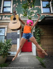 Ms. Mercury and the guitar. Photo by Eyoälha Baker www.jumpforjoyphotoproject.com