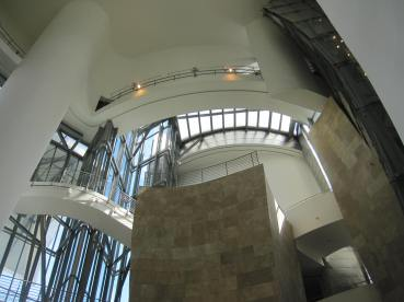 Looking up from atrium floor: limestone and glass