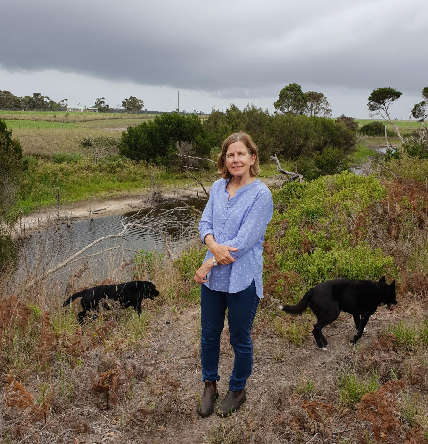 Elizabeth Balderstone stands next to Warrigal Creek on her farm in Victoria – the site of an 1843 massacre. Gunaikurnai people continue to visit the land to pay their respects. Photograph: Ciaran O'Mahony/The Guardian
